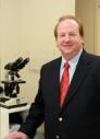 Dr. John B McElroy, MD
